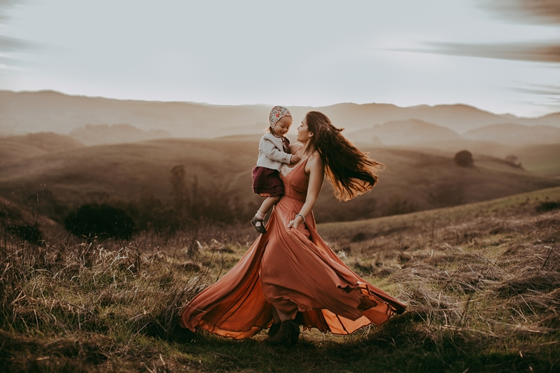 Sonoma Family Photography, mother twirling with baby girl in bonnet