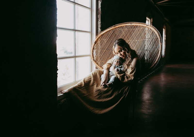 Sonoma Family Photography, mother holding baby in cobra chair
