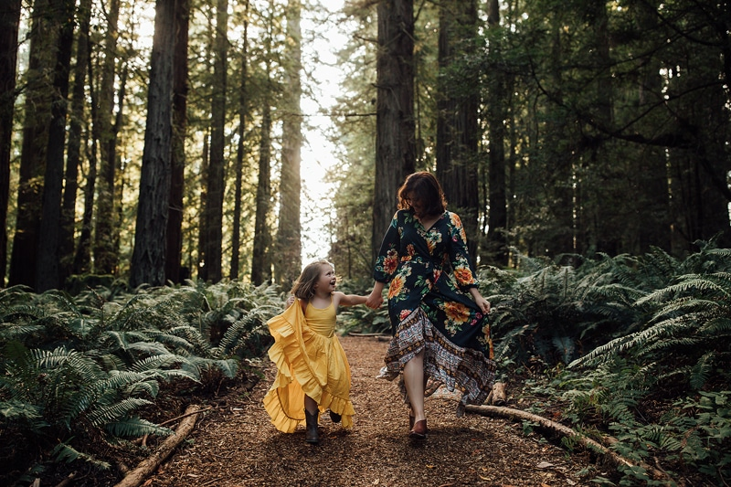 Sonoma Family Photography, mother and daughter walking together in forest
