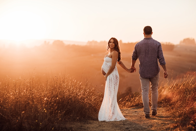 Sonoma Family Photography, man and pregnant woman walking down dirt path