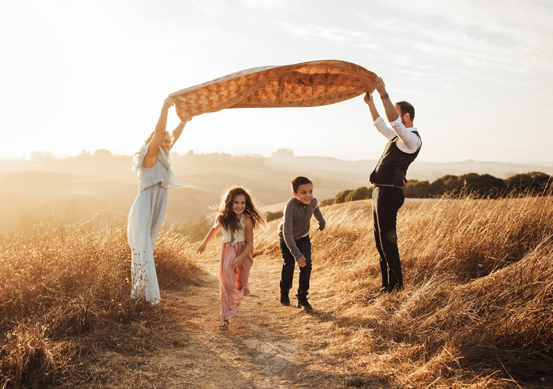 Sonoma Family Photography, family of four playing with blanket