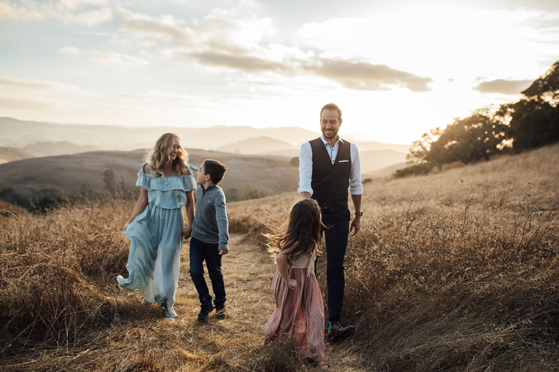 Sonoma Family Photography, family of 4 playing and walking on grassy pathway