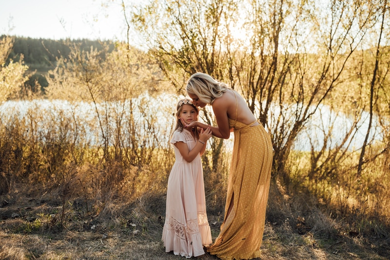 Sonoma Family Photography, mother leaning in to kiss daughter's head