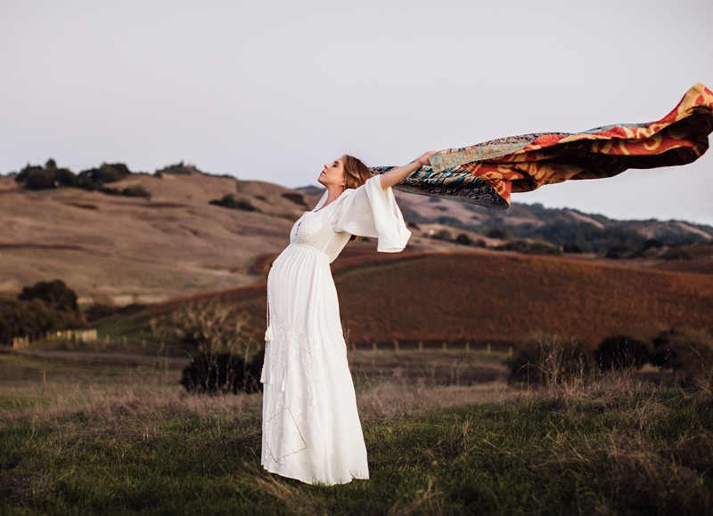 Sonoma Family Photography, pregnant woman flying a blanket behind her in the wind