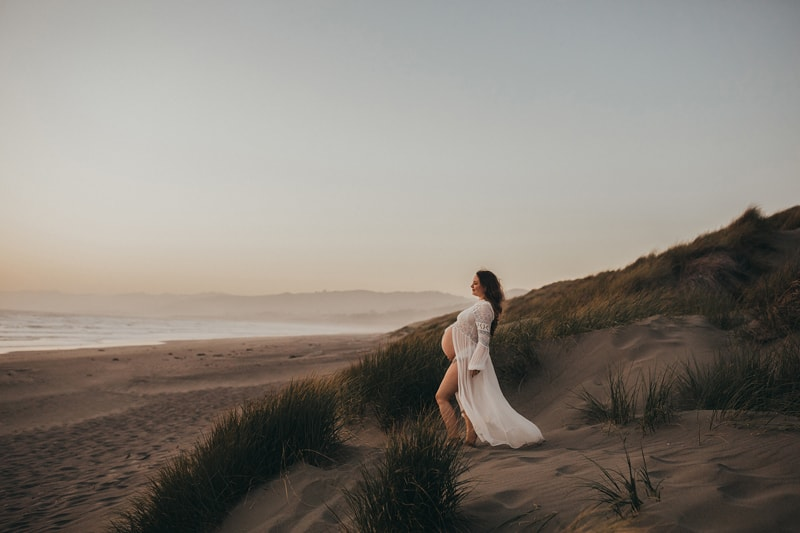 Sonoma Family Photography, pregnant woman standing by the ocean