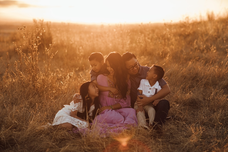 Sonoma Family Photography, family of 5 sitting together in a field of tall grass