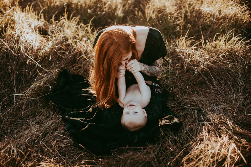 Sonoma Family Photography, woman playing with baby in field