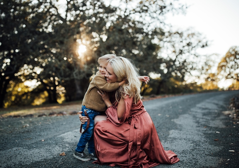 Sonoma Family Photography, mother kneeling to give son a big hug