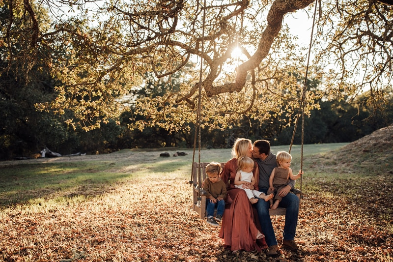 Sonoma Family Photography, family of five sitting on a bench swing