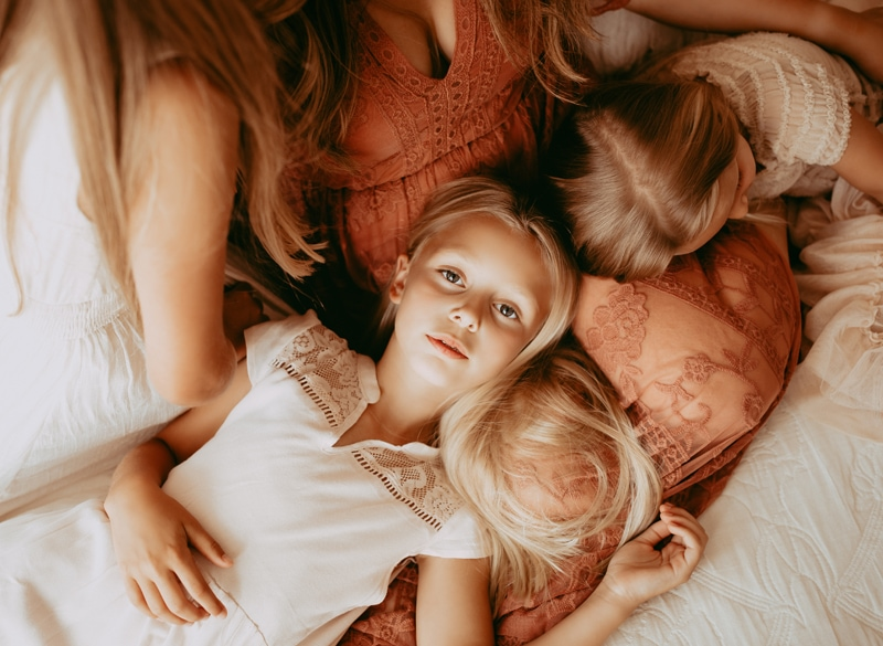 Sonoma Family Photography, mother in bed with her children around her